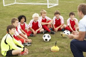 33604448 - junior football team training with coach